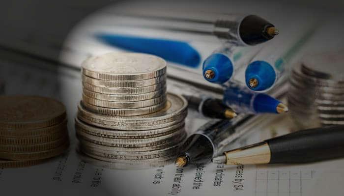 Monedas, boligrafos, sector financiero