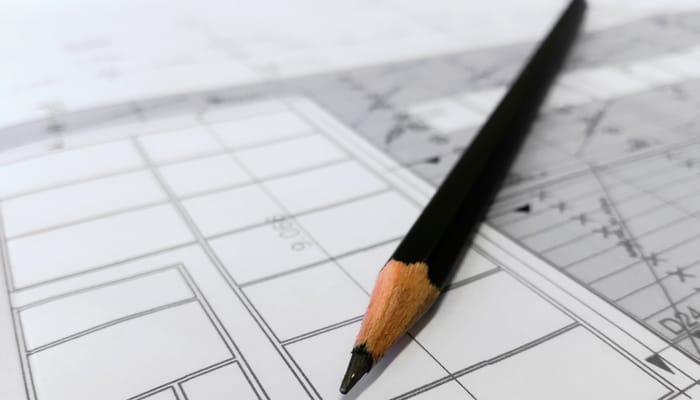 Imagen lápiz y plano ilustra comunicado ingenierías