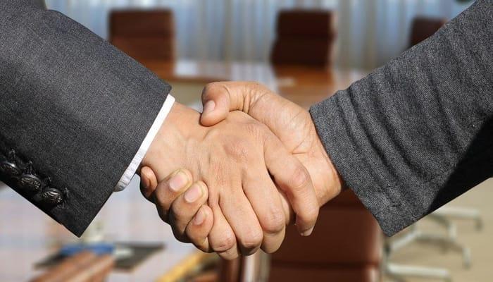 manos acuerdo convenio